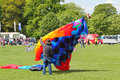 Man launching a large kite holding trying to get it to fly at festival this is the festival in bedford united kingdom and is Stock Photo