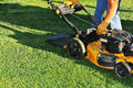 Man and Lawnmower Royalty Free Stock Photo