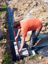 Man laying building foundation Royalty Free Stock Photography