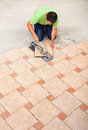 Man laying ceramic floor tiles top view with copy space Stock Image