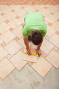 Man laying ceramic floor tiles top view with copy space Royalty Free Stock Photography