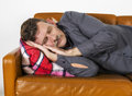 Man laying on couch and resting Stock Photography
