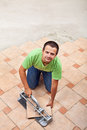 Man laying floor tiles with copy space ceramic top view Royalty Free Stock Photo