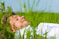 Man laying on a lawn and is dreaming Royalty Free Stock Photo