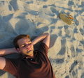 Man Laying On Sand Royalty Free Stock Photos