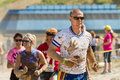 Man leading the pack at a mud race. Royalty Free Stock Photo