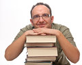 Man leaning on stack of books Stock Images