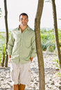 Man leaning on tree at beach Royalty Free Stock Photo