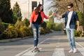 Man learns girlfriend to skateboard