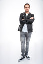 Man in leather jacket and jeans standing with arms crossed Royalty Free Stock Photo