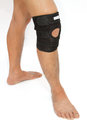 Man legs with one knee in a protective knee brace isolate Stock Photo