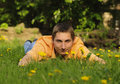 Man lie on the grass Royalty Free Stock Image