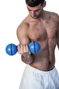 Man lifting blue dumbbell Royalty Free Stock Photo