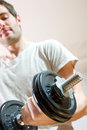 Man lifting dumbbell at home Royalty Free Stock Photography