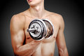 Man lifting dumbbell sexy muscular on black background Royalty Free Stock Photos