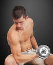 Man lifting dumbbell sexy muscular on black background Royalty Free Stock Photo