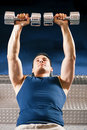 Man lifting dummbell in gym Stock Images