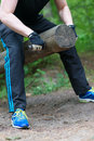 Man lifting log. Royalty Free Stock Photo