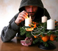 Man lighting candles Stock Images