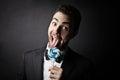 Man liking a lollipop Royalty Free Stock Photo