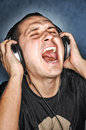 Man listen music headphones scream aloud Royalty Free Stock Photo