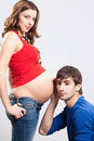 Man listen pregnant wife's belly Royalty Free Stock Photo