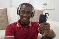 Man Listening Music On Headphones Royalty Free Stock Photo