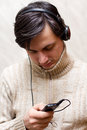 Man listening to music headphones Stock Photo
