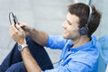Man listening to music portrait of young smiling Royalty Free Stock Photos