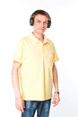 Man listens to music on headphones young and handsome listening Stock Photos