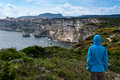 Man lloking at beautiful view a looks the white limestone cliffs of bonifacio corsica Stock Images