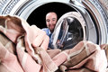 Man load washing machine Stock Photo