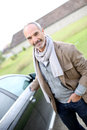 Man locking car with electronic key senior doors Stock Image