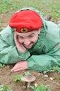 Man look on mushroom Stock Images