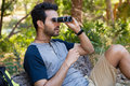 Man looking through binoculars in the forest Royalty Free Stock Photo