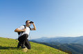 Man looking through the binoculars with in mountains Royalty Free Stock Photos