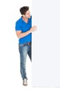 Man looking at blank billboard full length of young isolated on white background Royalty Free Stock Photo