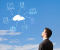 Man looking at cloud computing concept on blue sky handsome Stock Photos