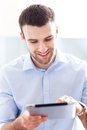 Man looking at digital tablet young Royalty Free Stock Photography
