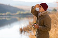 Man looking into distance happy young holding coffee mug and in winter morning Royalty Free Stock Photos