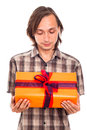 Man looking at gift Stock Images