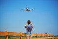 Man is looking at the glide path and landing plane Royalty Free Stock Photo