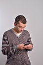 Man looking at his smart phone while text messaging Royalty Free Stock Photo