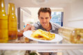 Man Looking Inside Fridge Full Of Unhealthy Food� Royalty Free Stock Photo