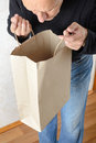 Man Looking Inside a Paper Bag Royalty Free Stock Photo