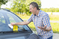 Man looking on parking ticket suprised placed under windshield wiper Stock Photo