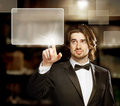 Man Looking and Pointing a Touch Screen Stock Photo