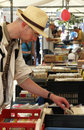 Man looking at second hand books on a stall Royalty Free Stock Photo
