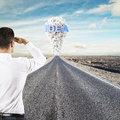 Man looking to idea standing on road Stock Image