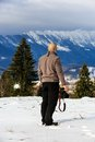 Man looking to a mountain winter landscape Royalty Free Stock Photo